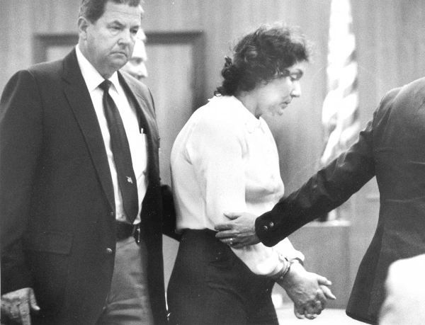 Handcuffed Judias Buenoano is led by US Marshal. Source: United States District Court.