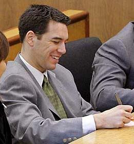 Scott Peterson smiling in court